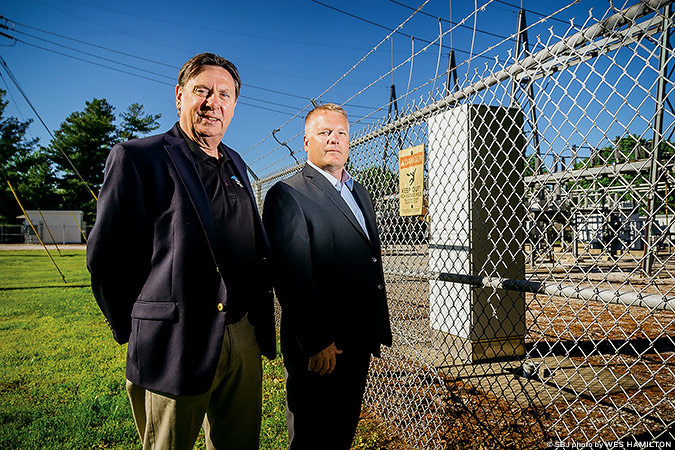 ENERGY BOOST: Frank Fleming and Jay Lohrbach are teaming up to develop a battery-powered energy storage system at a City Utilities substation.