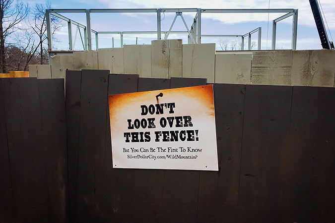 NO PEEKING?: A sign teases patrons of Silver Dollar City. Behind the fencing, the makings of a new ride are visible.Photo provided by SILVER DOLLAR CITY