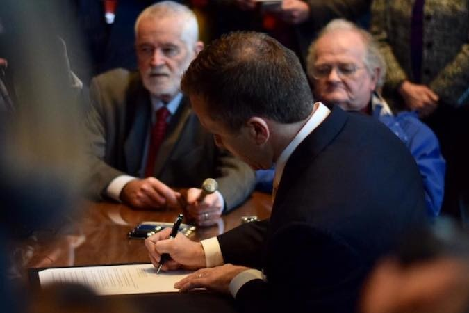 Shortly after being sworn in as governor, Eric Greitens signs an executive order banning executive branch employees from accepting lobbyists' gifts.