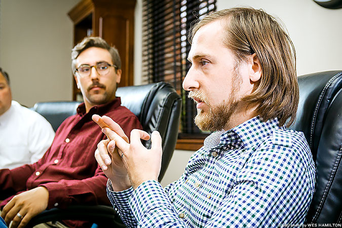 Kurt Theobald, right, gives Chris Olson advice on business plans. Early in the startup process, they might be frivolous, he says.