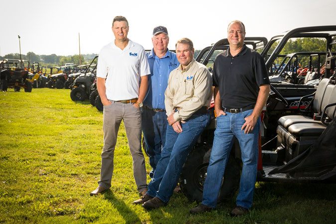 Caleb Wehrman, left, general manager; Max Stephans, ag sales manager; Kenny Bergmann, corporate sales manager; and Eric Schnelle, president