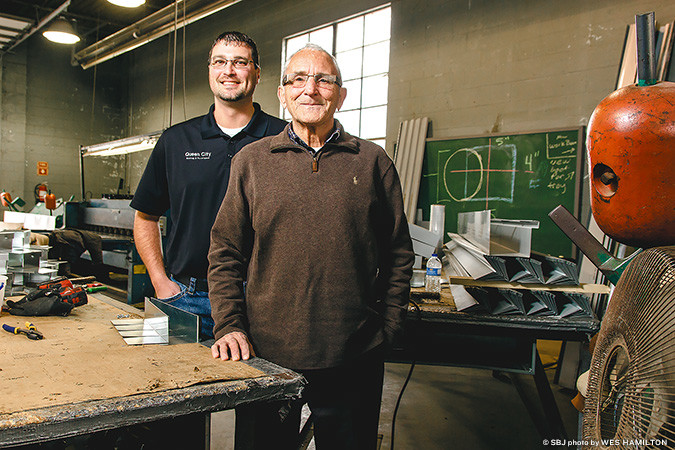 General Manager Michael Katrosh, left, and owner Larry Stock are leading QCR's upward revenue trend that totaled $8 million last year.