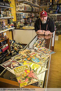 Comic Cave owner Josh Roberts says his Fremont Center shop houses some 20,000 comic books, including a Green Lantern collector item valued at $300.