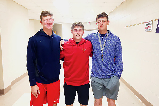 Nixa High School students Brett Hammitt, left, Connor Matthews and Jack Sanders took first place against 900 teams in the spring 2017 Missouri Stock Market Game. Students invest a virtual $100,000 over a 14-week period. Each team receives online daily portfolio updates on their current holdings, brokerage fees, interest and team rankings as they navigate the markets.Photo provided by NIXA PUBLIC SCHOOLS