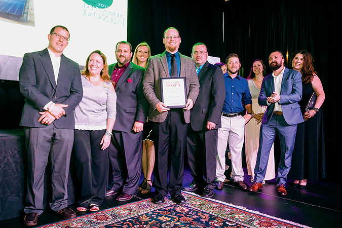 CEO Caleb Arthur and his Sun Solar LLC team celebrate their No. 1 status for this year's Springfield Business Journal Dynamic Dozen. More than 200 gathered for the May 11 event at The Old Glass Place to celebrate fast-growth companies and corporate leaders.SBJ photo by WES HAMILTON