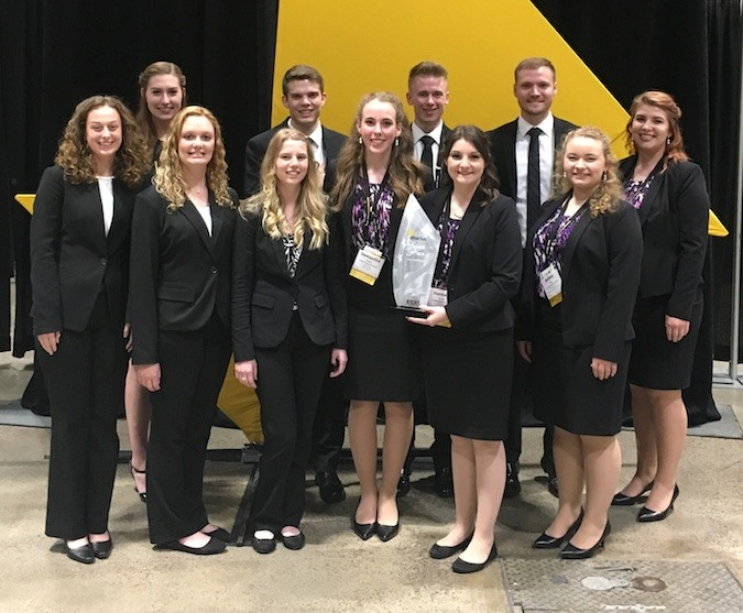 Southwest Baptist University's Enactus team matched its best result during the Enactus U.S. National Exposition by placing in the top eight May 23 at the Kansas City Convention Center. The 11 team members are pictured with their trophy.Photo provided by SOUTHWEST BAPTIST UNIVERSITY
