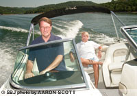 Creagh Tucker, member services director for Branson Boat Club, pilots co-owner Jay Finley III in one of the club's SeaRays on Table Rock Lake.