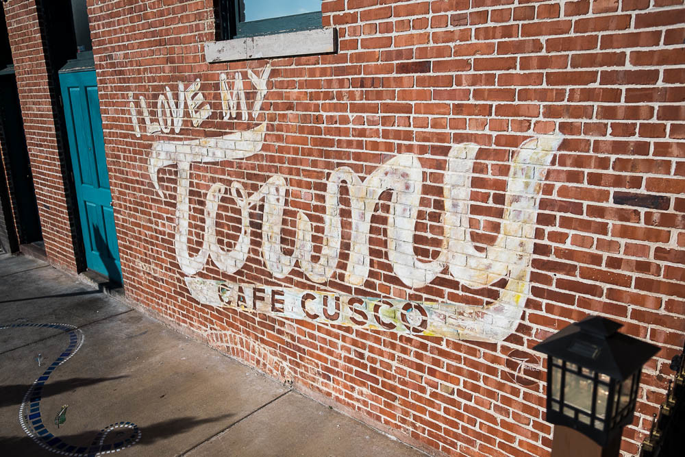 LOCAL TOUCH: A hand-painted sign on Cafe Cusco's building is remnant of the Towny app.