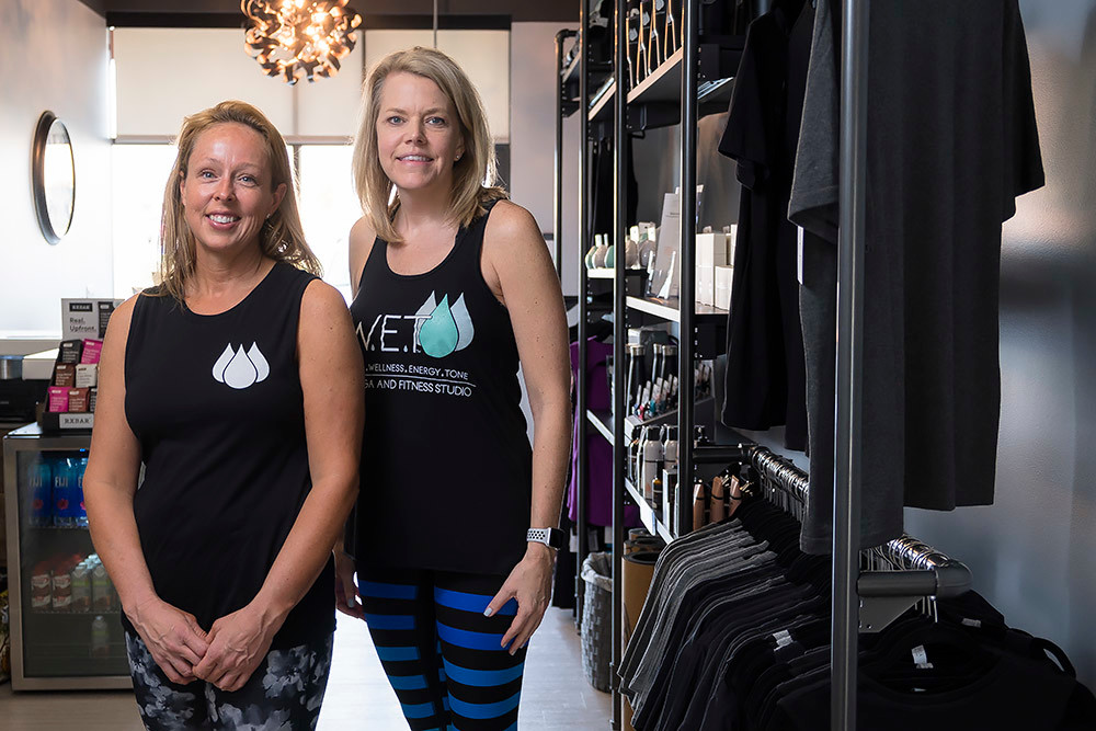Shelli Luke, left, manages operations for Virginia Bailey and other owners of the newly opened SWET yoga studio.