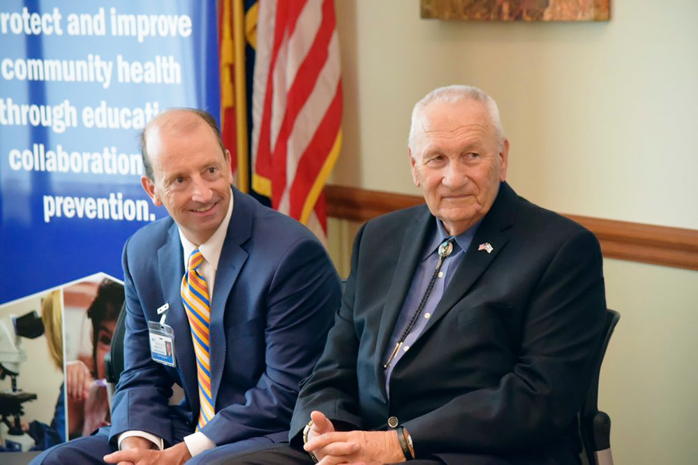 CoxHealth CEO Steve Edwards, left, sit next to award namesake Harold Bengsch during an April 6 ceremony.