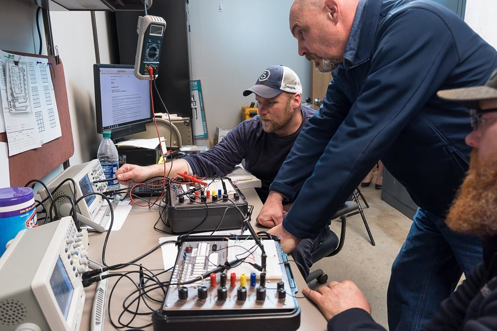 CU apprentices learn technical skills on the job, while also earning college degrees.