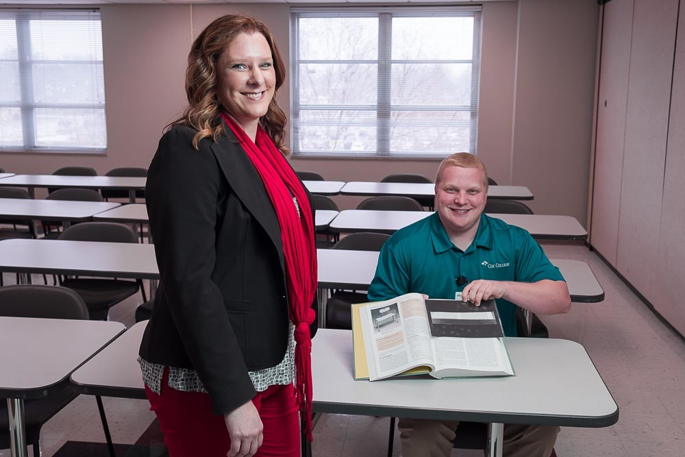 PROBLEM SOLVING: Amy Vaughn, chairwoman for Cox College's master's in occupational therapy, and student Chris Trout demonstrate a reading assistance product made by Trout.