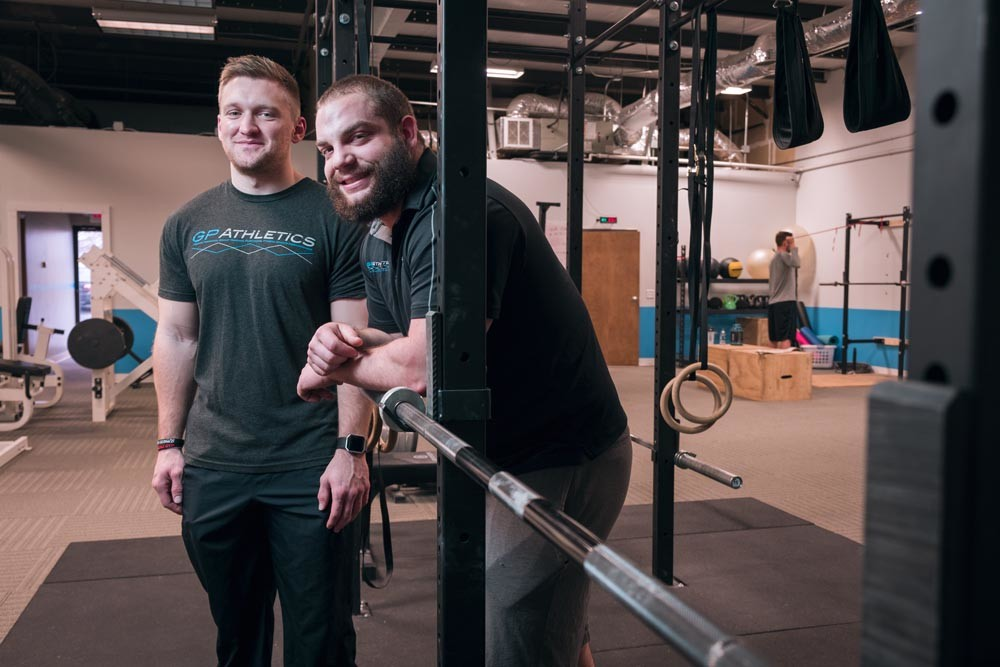 ADDING MASS: Patrick Posten, left, and Spencer Graham used an $8,000 loan to start their fitness business.
