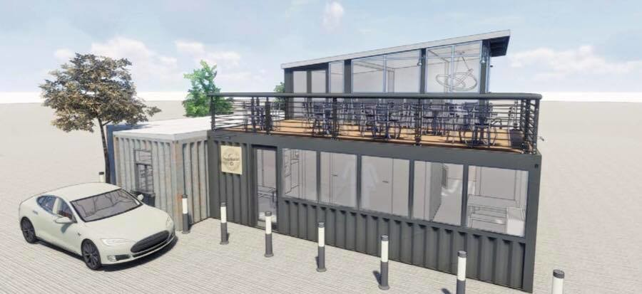 The concept utilizes shipping containers and focuses on environmentally friendly materials and organic food.