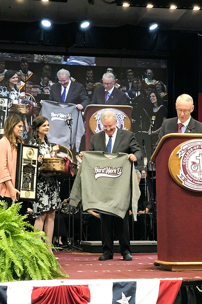 "Forbes receives his Hard Work U. sweatshirt and handmade gifts from students. Earlier, Davis said, ""There are no snowflakes here. We think that work ethic and free enterprise go hand in hand."""