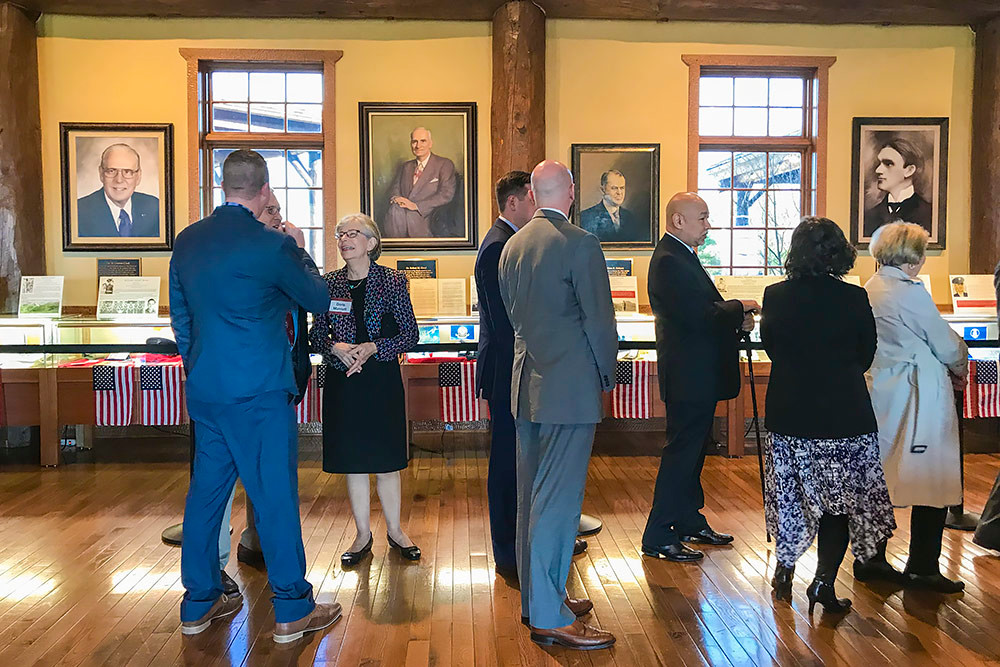 Before the convocation, attendees pass through the college's Ralph Foster Museum in line to meet Forbes for a quick picture.
