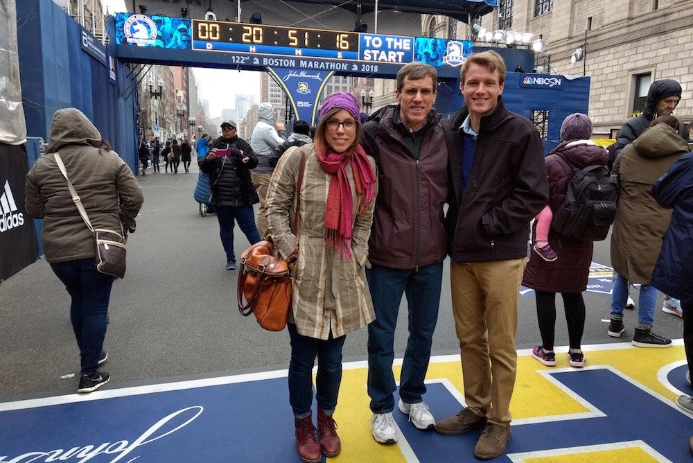 Brian Hammons, center, poses at the Boston Marathon finish line with his daughter April and son Adam.