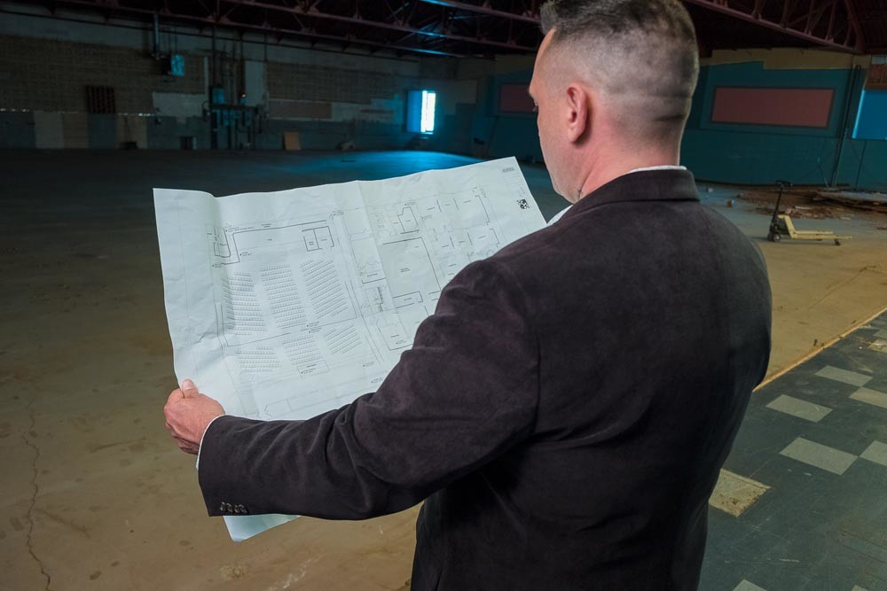 John Stroup reviews plans for Freeway Ministries' new church inside a former bowling alley.