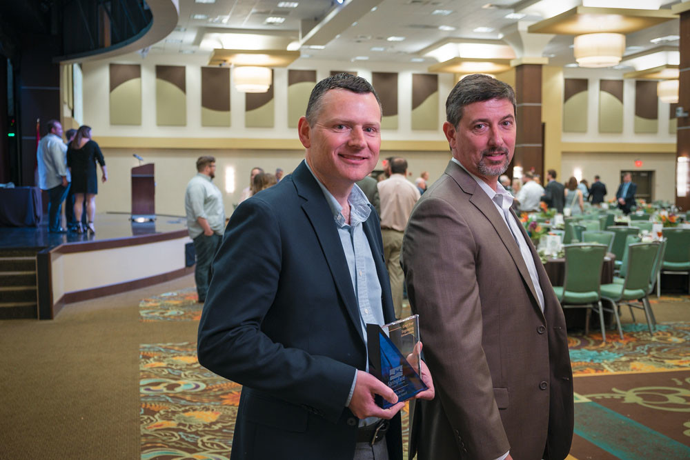 TOP HONOR: Great River Engineering principals Mel Eakins, left, and Spencer Jones accept the chamber's 2018 W. Curtis Strube Small Business Award.