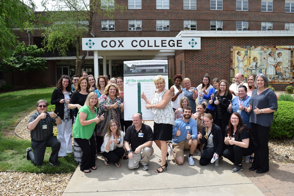 Cox College officials tally the final dollars for its fundraising campaign.