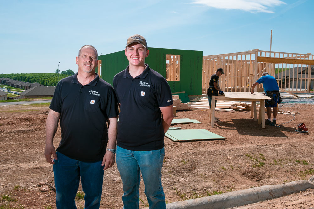 Bussell Building co-owners Kenny and Tyler Bussell say a shortage of new homes is driving their construction business.