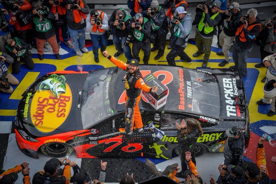 Decked in Bass Pro Shops gear, Martin Truex Jr. celebrates his win at the Pocono Raceway in Long Pond, Pennsylvania.
