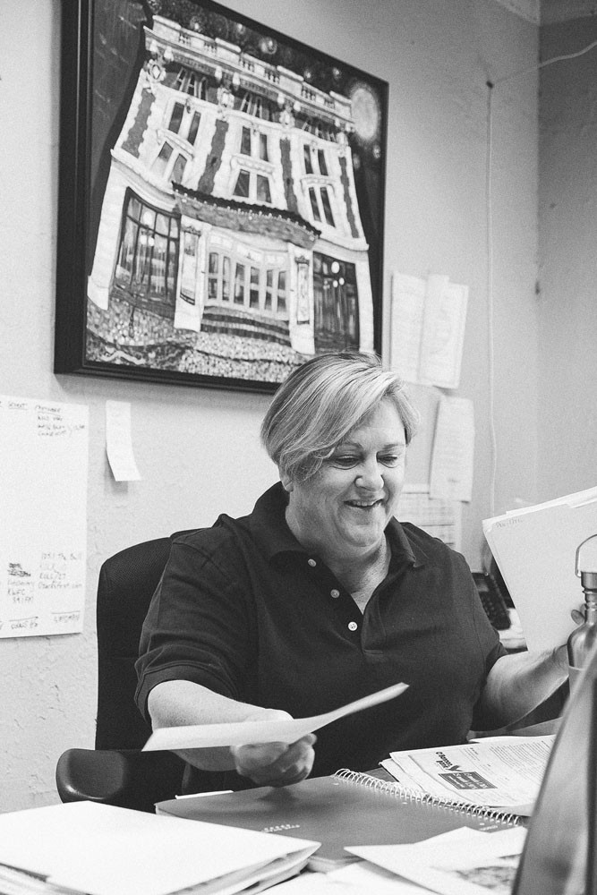 Domann organizes her desk in her Springfield Little Theatre office, where she's worked for more than 21 years.