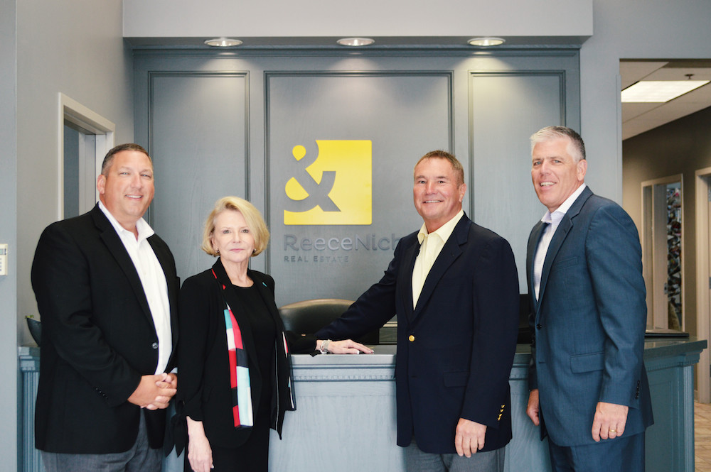 CJR CEO Shaun Duggins, left, is transitioning to president of ReeceNichols' southern region. He's pictured with Linda Vaughan, CEO of ReeceNichols, Rick Witeka, general manager of ReeceNichols' southern region, and Mike Frazier, president and CFO of ReeceNichols.