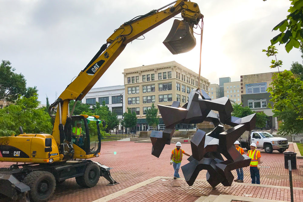 A Springfield Public Works crew rotates the Tumbler on the first day of summer, June 21.