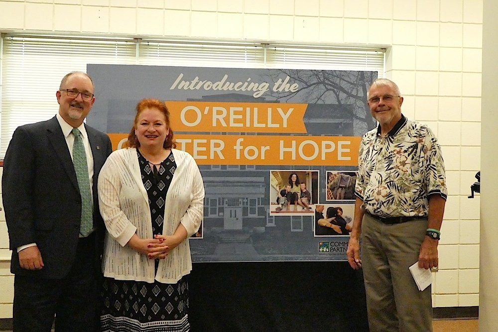 Outgoing Springfield City Manager Greg Burris, left, CPO CEO Janet Dankert and Charlie O'Reilly unveil the O'Reilly Center for Hope name for a community hub at the former Pepperdine Elementary School.