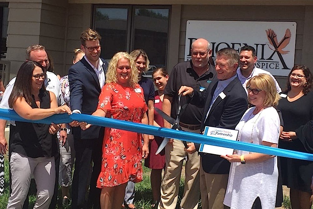 Phoenix Home Care Inc. owner and CEO Phil Melugin cuts the ribbon on the company's Topeka, Kansas, office.