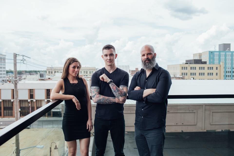 The Progress and Reverie team comprise, from left, Cassidy Rollins, Daniel Ernce and Michael Schmitz.