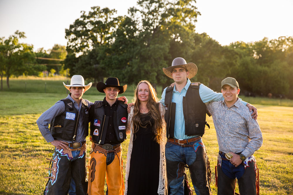 RODEO THEME: Founder Sheri Smith, center, poses with members of her Warriors and Rodeo nonprofit, which serves military veterans and first responders. She says many young vets get into rodeo.