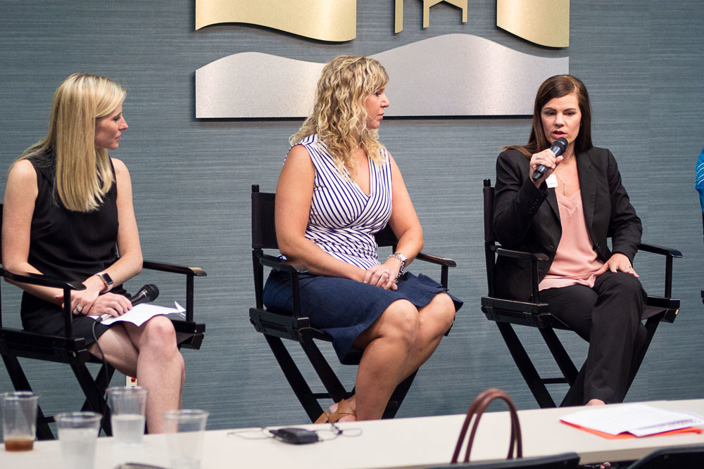 Missouri State University's Amy Marie Aufdembrink, right, explains the Bachelor of Studies program as Catherine Bass Black of Bass Pro Shops, left, and Joselyn Baldner with Central Bank of the Ozarks listen at a panel discussion about employer educational support.