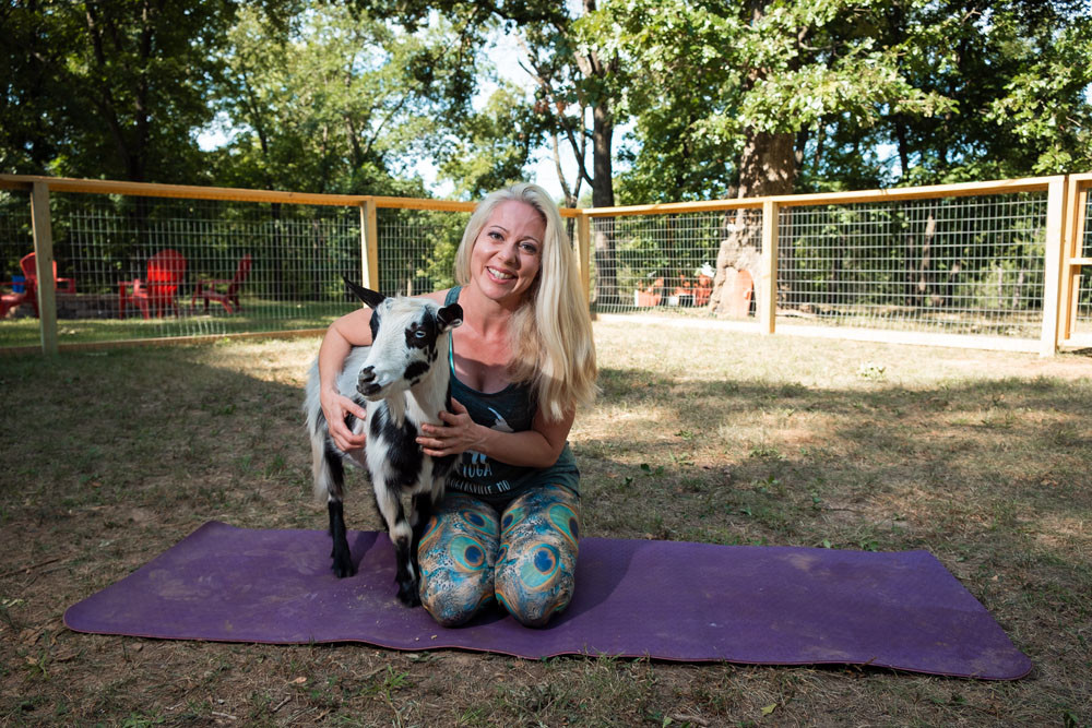 FARM FRIENDLY: With Don Draper by her side, Stephanie Wubbena instructs Goats and Yoga in Rogersville.