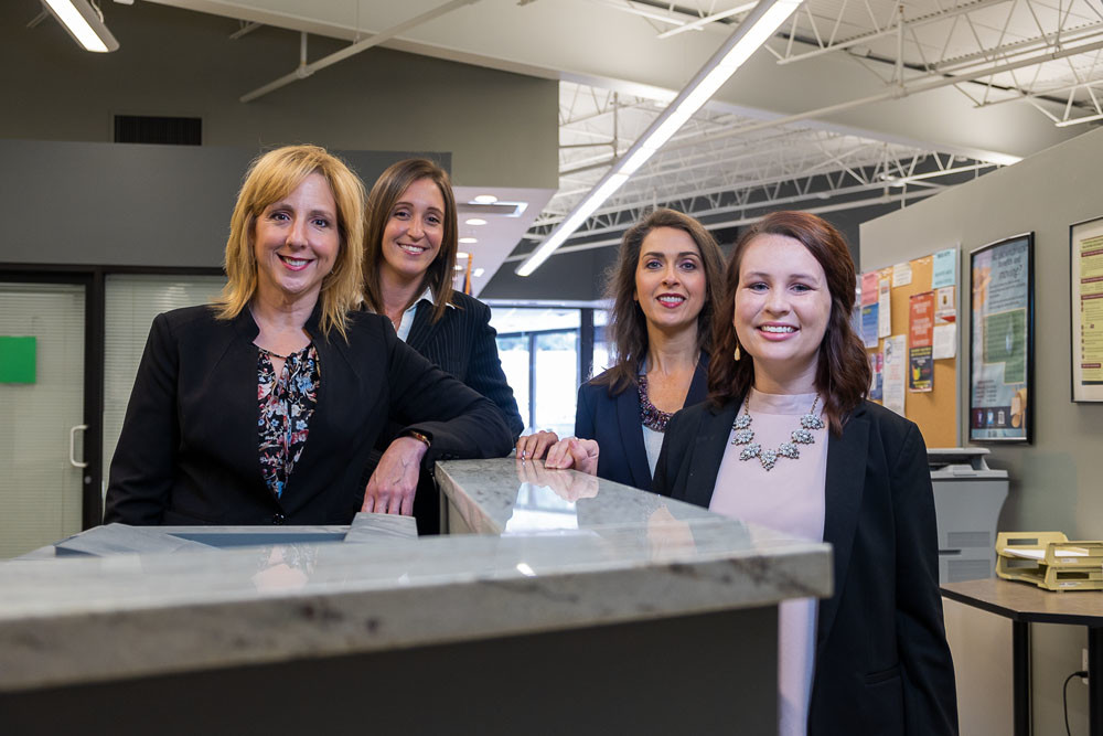 From left, Sherry Coker, Sara Coatney, Cary Charles and Breanna O'Bryan make up part of the team at Ozarks Technical Community College Center for Workforce Development, which has partnered with more than 100 businesses and organizations over the past three years.