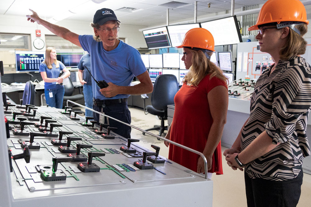ENERGIZING TOUR: Kent Potts of City Utilities explains the control room operations at the John Twitty Energy Center to teachers Kelly Prude, center, and Tiffany Lindley. The teachers are part of an externship program.