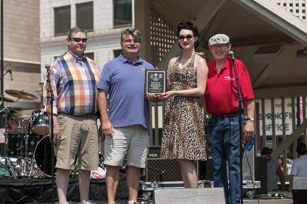 Jeff Schrag, second from left, receives the John T. Woodruff Award. He's joined by Woodruff's grandson, John T. Woodruff III, left, and Birthplace of Route 66 Festival co-founder David Eslick, right.