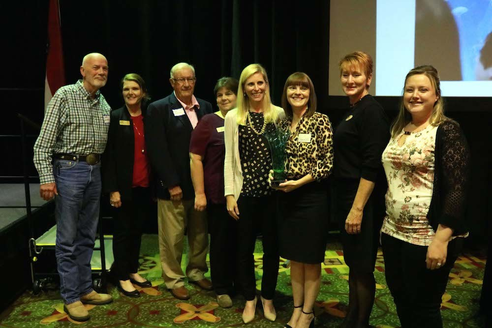 Foundation for Springfield Public Schools Executive Director Natalie Murdock, third from right, honors Bass Pro Shops as Corporate Partner of the Year. Pictured from left are Larry Whiteley, Janet Furneaux, Edsel Matthews, Misty Mitchell, Catherine Bass Black, Murdock, Sue Dial and Courtney Reece.