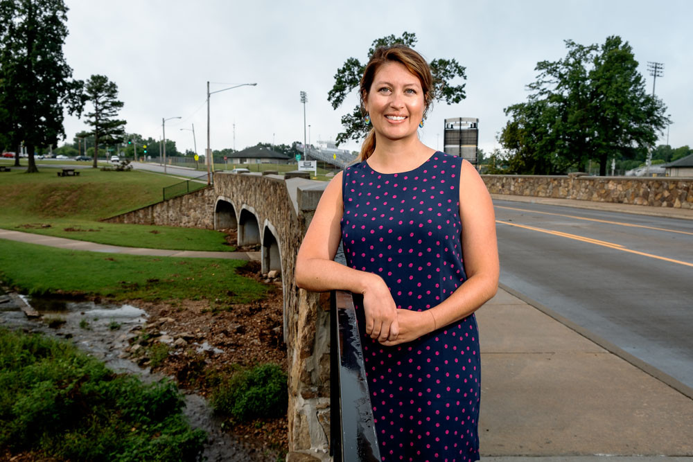 VERDANT PASSAGE: Ozark Greenways Executive Director Mary Kromrey poses next to the Fassnight Creek Greenway, where the Grant Avenue Parkway Trail Connection Project is proposed.