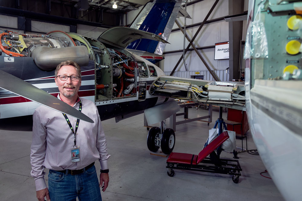 Worldwide Aircraft Services Inc. Administrator Dave Vorbeck poses with a plane that is currently being serviced.