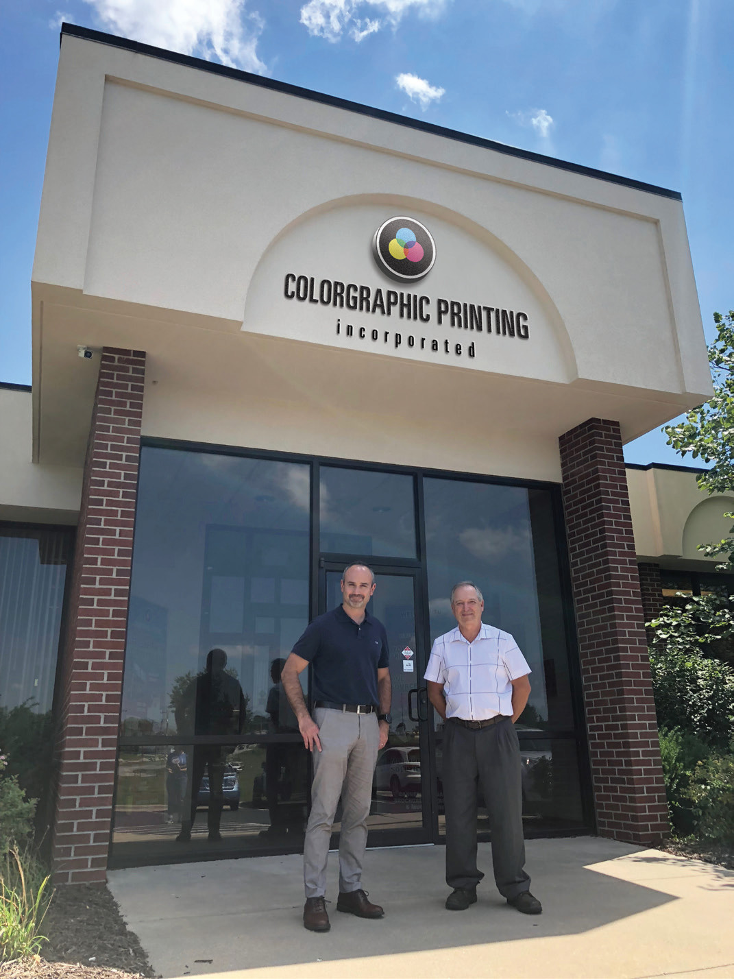 Robert McCann, right, sells McCann Printing to Color-Graphic Printing, led by CEO Grant Johnson.