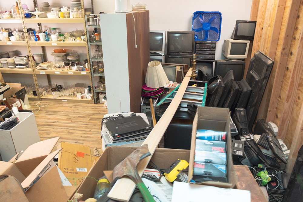 An area of the shop is filled with breakable inventory the business acquires through estate sales and donations.