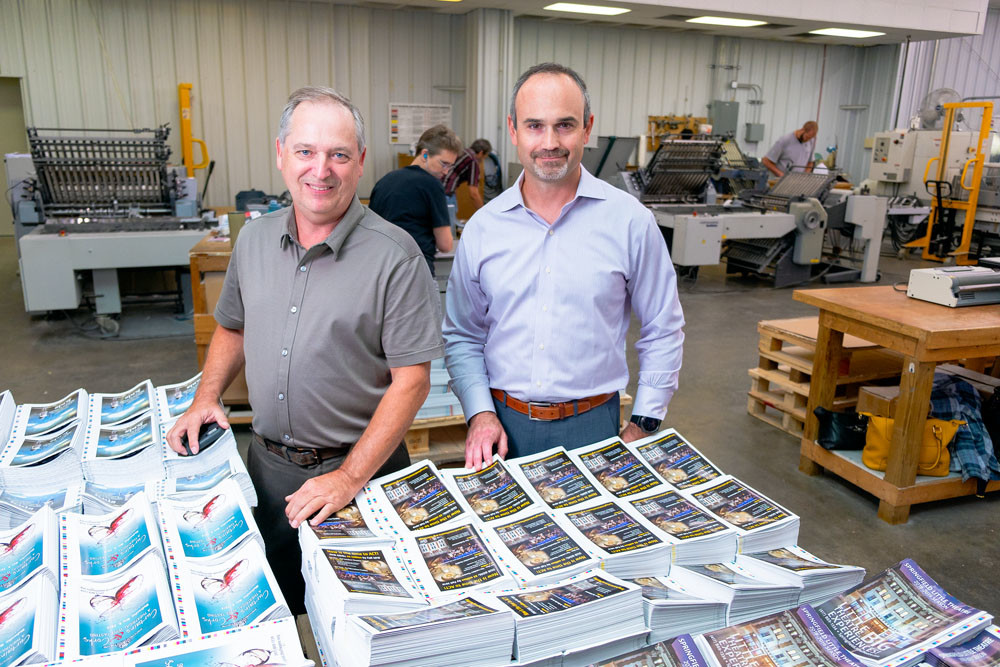 JOINING FORCES: With the purchase of Robert McCann's company, Color-Graphic CEO Grant Johnson, right, leads the combined commercial printer.