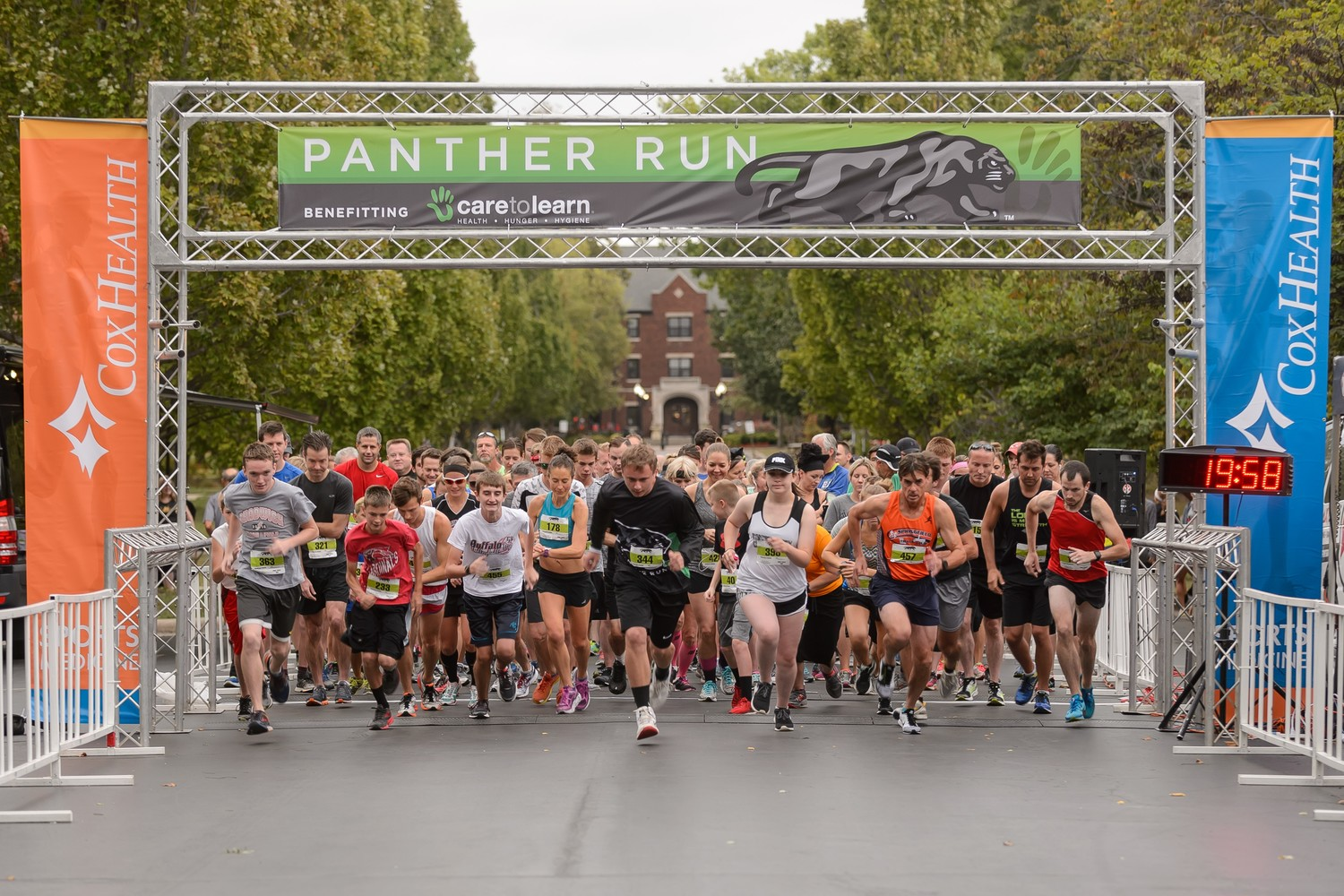 Runners take off at the 2017 Panther Run benefitting Care to Learn.