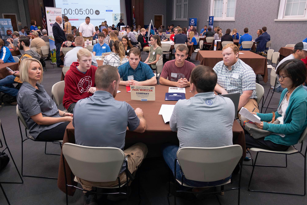Ozarks Technical Community College students visit with Paul Mueller Co. representatives at an Oct. 4 speed dating-style jobs event.