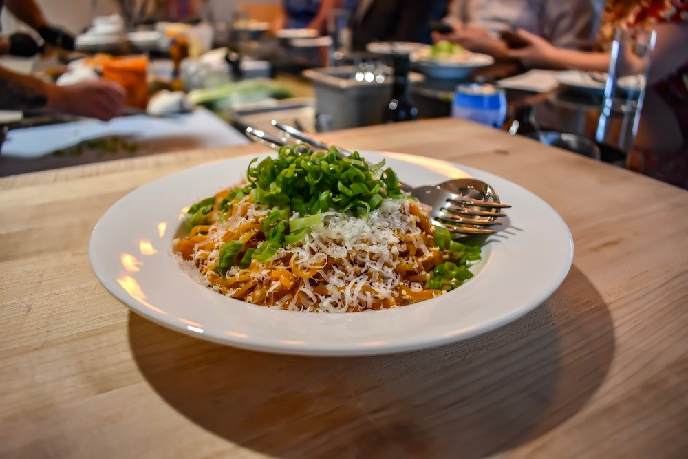 "A heaping bowl of spicy Korean buttered noodles are on the menu at Progress. Fresh ramen noodles are tossed in Korean ""buffalo sauce"" and served with parmesan cheese, sesame seeds and scallions."