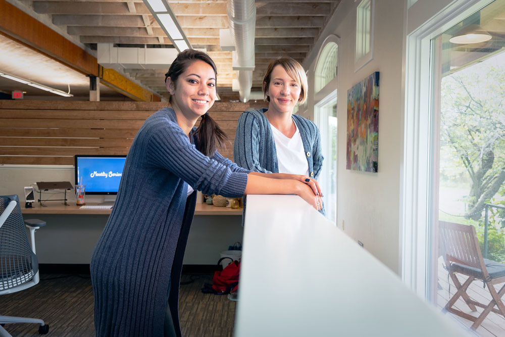NEW DIGS: Becca Godsey, left, and Molly Riddle-Nunn of Mostly Serious develop digital marketing content for clients out of the agency's new location on Line Pine Avenue.