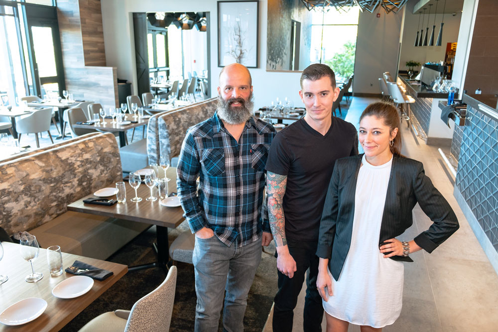 COMMUNITY MEALS: With two years of executing pop-up dinner events under their belt, Progress co-owners, from left, Michael Schmitz, Daniel Ernce and Cassidy Rollins now run a brick-and-mortar restaurant in Farmers Park.