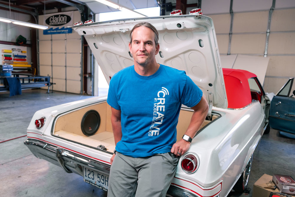 CUSTOMIZATION: Creative Audio owner Don Fleury is working on installing a custom-built trunk unit in this 1965 Chevy Impala.
